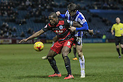 Nedum Onuoha (C) (QPR) holds off Kieran Lee (Sheffield Wednesday) during the Sky Bet Championship match between Sheffield Wednesday and Queens Park Rangers at Hillsborough, Sheffield, England on 23 February 2016. Photo by Mark P Doherty.