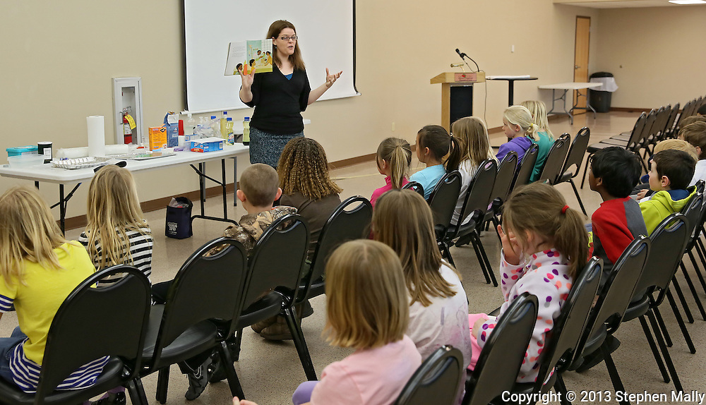 Michelle Poe, Director of Education, talks to students from Westfield Elementary School about George Washington Carver during a workshop at the African American Museum of Iowa in Cedar Rapids on Friday, March 22, 2013.