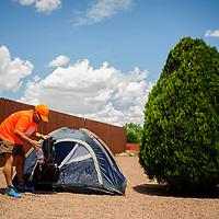 Cesar Becerra unpacks his bag at his campsite in Gallup Monday.