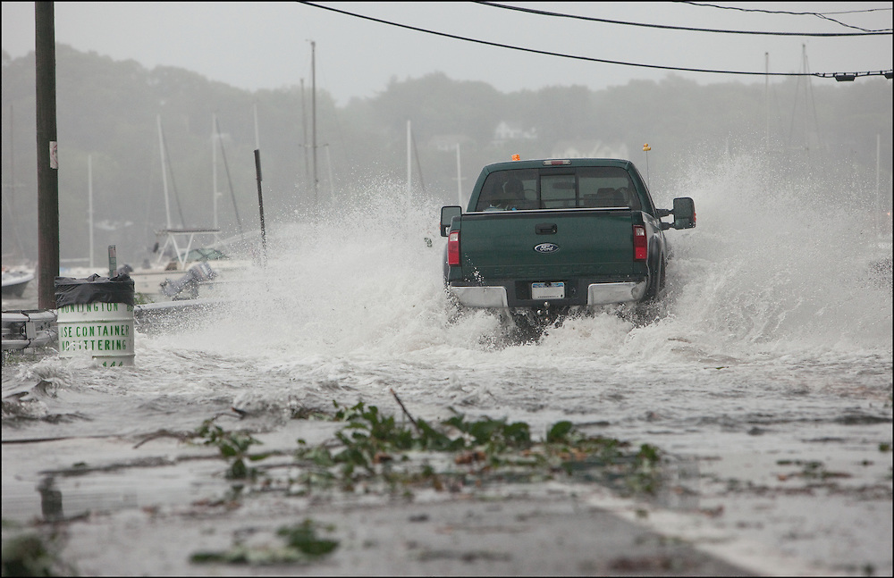 A truck driving through flood waters caused by Hurricane Irene pushing water from the Long Island Sound into Huntington Bay, New York.