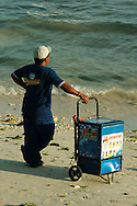 Ice cream vendor taking a break at Alona Beach on Panglao Bohol,  famous for its white sand stretching for one and a half kilometers and ending in rocky cliffs. It is the most developed beach in Bohol and one of the top tourist destinations in the Philippines especially for aficionados of diving and snorkeling.