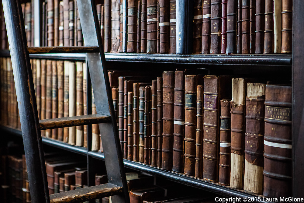 Vintage Leather bound books on a shelf in Trinity College's Old Library, Dublin, Ireland