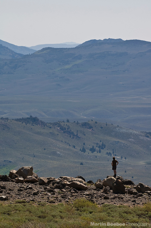 A hiker contemplates an Eastern Sierra valley, Toiyable National Forest, California