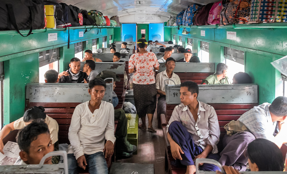 YANGON, MYANMAR - CIRCA DECEMBER 2013:  People inside a typical wagon of the Yangon circular railway service, awaits to depart from Yangon Central Railway Station