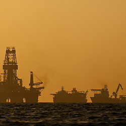 The Transocean Development Driller III leased by BP Plc is seen near sunset at the BP Plc Macondo well site in the Gulf of Mexico off the coast of Louisiana, U.S., on Thursday, July 29, 2010. BP Plc continues to work on a relief well to permanently plug the source of the largest oil spill in U.S. history.  Photographer: Derick E. Hingle/Bloomberg