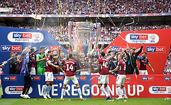 Aston Villa players celebrate promotion to the Premier League after the final whistle