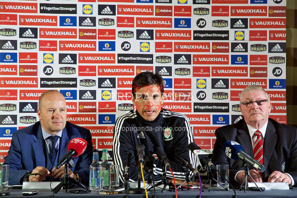 CARDIFF, WALES - Monday, May 23, 2016: Wales national team manager Chris Coleman with Chief-Executive Jonathan Ford [L] and FAW President David Griffiths [R] during a press conference at the Vale Resort Hotel to announce his contract extension until the end of the 2018 World Cup Qualifying campaign. (Pic by David Rawcliffe/Propaganda)