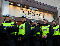 © Licensed to London News Pictures. 17/12/2011. LONDON, UK. Metropolitan Police Territorial Support Group (TSG) officers are seen guarding the front of Topshop's flagship Oxford Street store from UK Uncut protesters in London today (17/12/11). Demonstrators had intended to hold a protest inside the shop, but the few that gained entry were ejected by security and police. Photo credit: Matt Cetti-Roberts/LNP