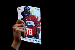 A fan holds up the match day programme with Ugo Ehiogu on the front cover who died suddenly last week - Mandatory by-line: Robbie Stephenson/JMP - 26/04/2017 - FOOTBALL - Riverside Stadium - Middlesbrough, England - Middlesbrough v Sunderland - Premier League