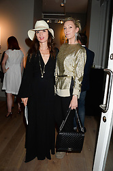 Left to right, LARA BOHINC and OLIVIA BUCKINGHAM at Harper's Bazaar & Viva Model Management London opening of a Self-Portraits exhibition at the Moretti Galery, Ryder Street, London on 3rd September 2013.