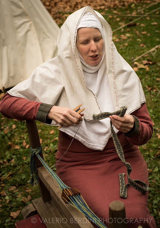 Weaving a belt. It's been 950 years since King Harold got an arrow in the eye at the Battle of Hastings. A group of re-enactors set up a camp near Apsley House in Hyde Park, London, to show their weapons, games and living arrangements.