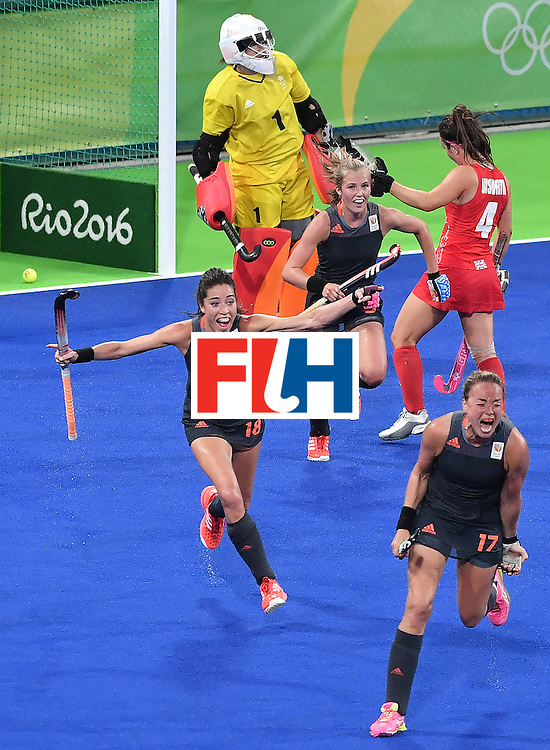 Netherlands' Maartje Paumen (bottom) celebrates after scoring a goal during the women's Gold medal hockey Netherlands vs Britain match of the Rio 2016 Olympics Games at the Olympic Hockey Centre in Rio de Janeiro on August 19, 2016. / AFP / Pascal GUYOT        (Photo credit should read PASCAL GUYOT/AFP/Getty Images)