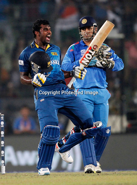 Thisara Perera celebrates the win. ICC T20 cricket World Cup Final - Sri Lanka v India, Sher-e-Bangla National Cricket Stadium, Mirpur, Bangladesh, 6 April 2014. Photo: www.photosport.co.nz
