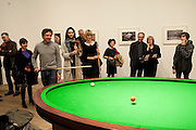 CRISPIN SOMERVILLE; LILY COLE; ILLY FRAITURE PLAYING Gabriel Orozco's 'Carambole with a Pendulum?  (an oval-shaped billiard table with no pockets ), Gabriel Orozco reception, Tate Modern, London. 18 January 2010. .-DO NOT ARCHIVE-© Copyright Photograph by Dafydd Jones. 248 Clapham Rd. London SW9 0PZ. Tel 0207 820 0771. www.dafjones.com.