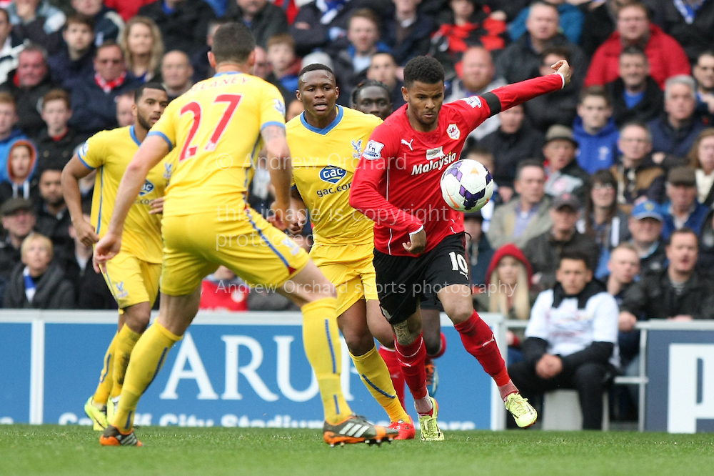 Fraizer Campbell of Cardiff city (r) looks to go past Damien Delaney of Crystal Palace. Barclays Premier league match, Cardiff city v Crystal Palace at the Cardiff city stadium in Cardiff, South Wales on Saturday 5th April 2014.<br /> pic by Mark Hawkins, Andrew Orchard sports photography.