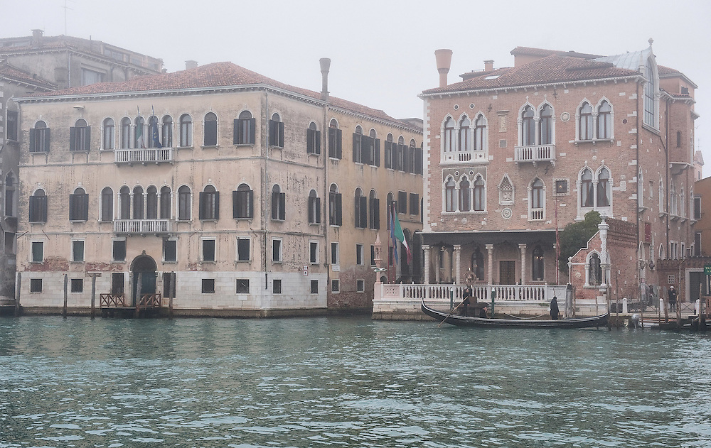 VENICE, ITALY - JANUARY 05:  A gondola stops in front of a palace on the Grand Canal as thick fog shrouds the city, on January 5, 2012 in Venice, Italy. Venice woke up this morning under a heavy blanket of fog adding to the atmosphere of the city.