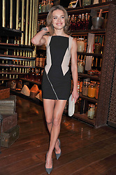 NATALIA VODIANOVA at a dinner to celebrate the beginning of a unique partnership between The Naked Heart Foundation and W's Newest Hotel W St.Petersburg -The 'For Russia With Love' dinner was hosted by Sadie Frost and Natalia Vodianova at Spice Market restaurant, W London, Leicester Square, London on 2nd June 2011.