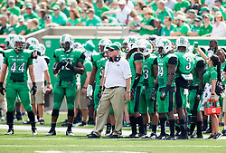 Sep 6, 2015; Huntington, WV, USA; Marshall Thundering Herd head coach Doc Holliday stands on the sidelines with his players during the first quarter against the Purdue Boilermakers at Joan C. Edwards Stadium. Mandatory Credit: Ben Queen-USA TODAY Sports