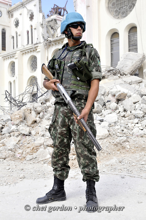 A UN soldier from Brazil stands guard outside the collapsed Cathedral in Port-au-Prince, Haiti on Saturday, January 30, 2010. A massive 7.0 earthquake struck the Caribbean island nation on January 12th., killing upwards of 200,000 people.