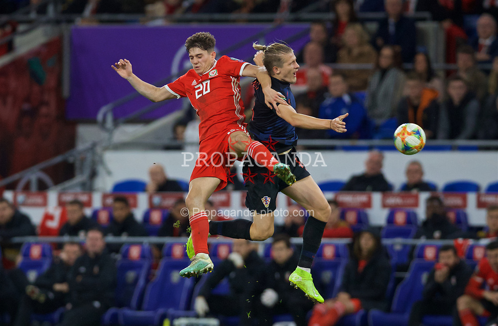 CARDIFF, WALES - Sunday, October 13, 2019: Wales' Daniel James (L) challenges for a header with Croatia's Tin Jedvaj during the UEFA Euro 2020 Qualifying Group E match between Wales and Croatia at the Cardiff City Stadium. (Pic by Laura Malkin/Propaganda)