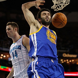 January 5, 2011; New Orleans, LA, USA; Golden State Warriors small forward Vladimir Radmanovic (77) dunks over New Orleans Hornets power forward Jason Smith (14) during the second half at the New Orleans Arena. The Warriors defeated the Hornets 110-103.  Mandatory Credit: Derick E. Hingle