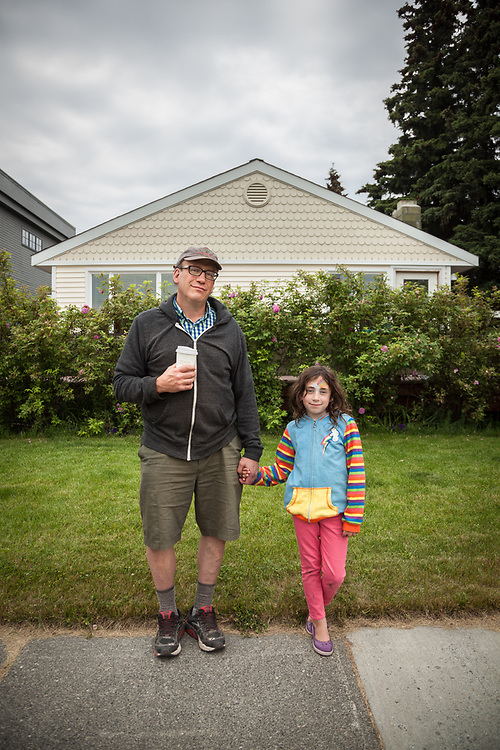 """Retired teacher Jonathan Halpern with his seven year old daughter, Naomi, in Anchorage's South Addition neighborhood.  """"We just stopped at Fire Island Bakery...we had chocolate cookies right out of the oven.""""  halpernjs@hotmail.com"""