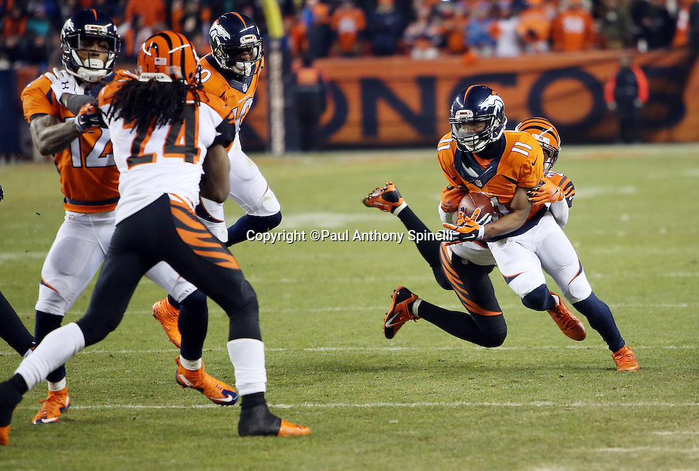 Denver Broncos wide receiver Jordan Norwood (11) gets tackled after catching a pass during the 2015 NFL week 16 regular season football game against the Cincinnati Bengals on Monday, Dec. 28, 2015 in Denver. The Broncos won the game in overtime 20-17. (©Paul Anthony Spinelli)