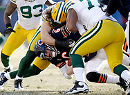 Green Bay Packers' Clay Matthews and Cullen Jenkins sack Chicago Bears' Jay Cutler for a loss in the 1st quarter. <br /> The Green Bay Packers traveled to Soldier Field in Chicago to play the Chicago Bears in the NFC Championship Sunday January 23, 2011. Steve Apps-State Journal.