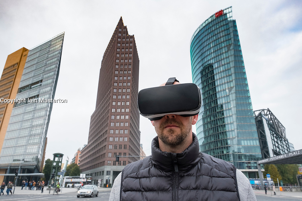 Man wearing Virtual Reality (VR) goggles at Potsdamer Platz in Berlin, Germany