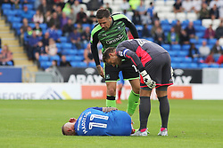 Marcus Maddison of Peterborough United receives some abuse from Sonny Bradley and Luke McCormick of Plymouth Argyle as he lays injured on the floor - Mandatory by-line: Joe Dent/JMP - 05/08/2017 - FOOTBALL - ABAX Stadium - Peterborough, England - Peterborough United v Plymouth Argyle - Sky Bet League One