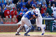 CHICAGO, IL - MAY 17: Darwin Barney #15 of the Chicago Cubs gets tagged out trying to score a run at home plate against John Buck #44 of the New York Mets during the game on May 17, 2013 at Wrigley Field in Chicago, Illinois. The Mets won 3-2. (Photo by Joe Robbins)