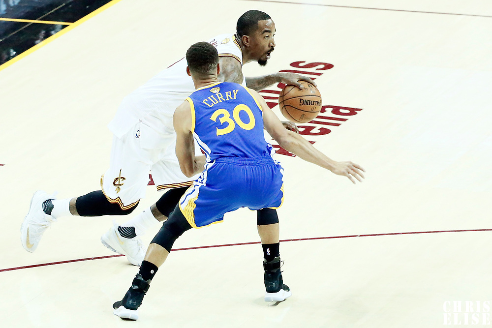 07 June 2017: Cleveland Cavaliers guard JR Smith (5) drives past Golden State Warriors guard Stephen Curry (30) during the Golden State Warriors 118-113 victory over the Cleveland Cavaliers, in game 3 of the 2017 NBA Finals, at  the Quicken Loans Arena, Cleveland, Ohio, USA.