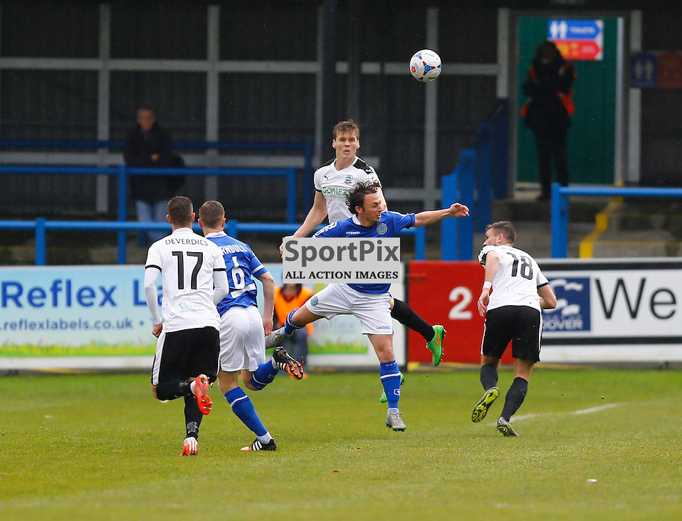 Dover's defender Sean Raggett (5) wins the ball in the air from Macclesfield Midfielder Danny Whitehead (18). Dover Athletic against Macclesfield Town in the Vanorama Conference Premier. At Crabble Stadium, Dover, Kent. (c) Matt Bristow | SportPix.org.uk