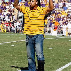 Oct 2, 2010; Baton Rouge, LA, USA; Former LSU Tigers star Chad Jones pumps up the crowd during the first half against the Tennessee Volunteers at Tiger Stadium. LSU defeated Tennessee 16-14.  Mandatory Credit: Derick E. Hingle