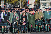 Veterans, incl Highland units, march past the Cenothaph and down Whitehall - Remembrance Sunday and Armistice Day commemorations fall on the same day, remembering the fallen of all conflicts but particularly the centenary of the end of World War One.