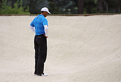 April 7, 2018 - Augusta, GA, USA - Tiger Woods contemplates his ball in a bunker on the 2nd hole during the third round of the Masters Tournament on Saturday, April 7, 2018, at Augusta National Golf Club in Augusta, Ga. (Credit Image: © Curtis Compton/TNS via ZUMA Wire)