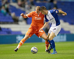 Millwall's Steve Morison is challenged by Birmingham City's Callum Reilly - Photo mandatory by-line: Nigel Pitts-Drake/JMP - Tel: Mobile: 07966 386802 01/10/2013 - SPORT - FOOTBALL - St. Andrew's - Birmingham - Birmingham City V Millwall