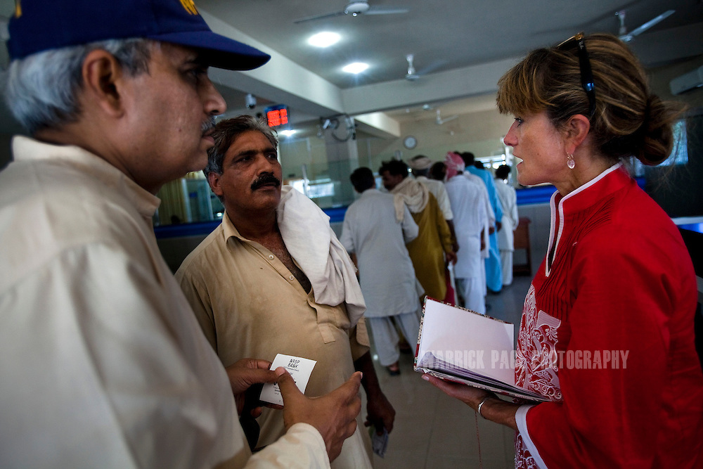 BAHAWALPUR, PAKISTAN - JUNE 18: Jacqueline Novogratz, CEO of Acumen Fund speaks with beneficiaries at the NRSP (National Rural Support Program) micro-financing regional branch, on June 18, in Bahawalpur, Pakistan.  (Photo by Warrick Page)