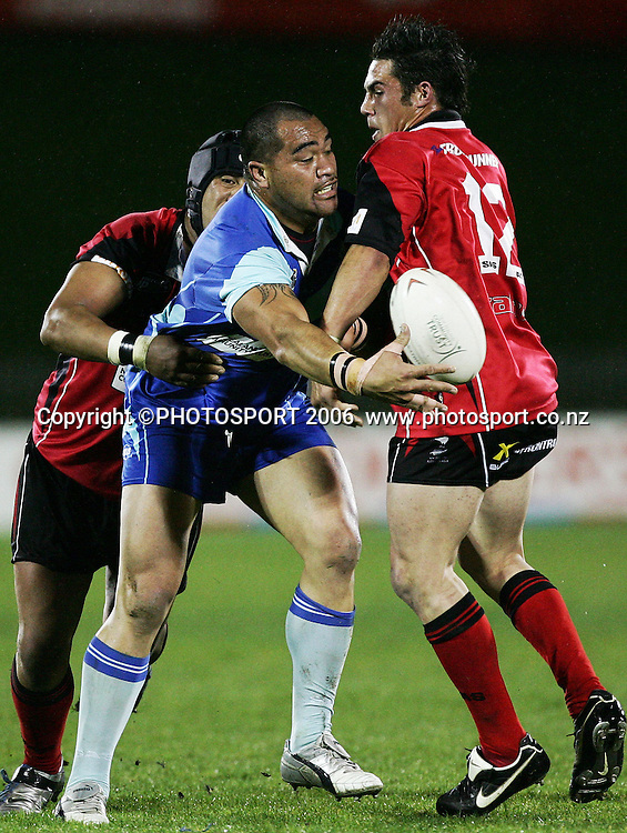 Tamaki Leopards prop George Tuakura offloads in the tackle during the Bartercard Cup rugby league semi final match between the Tamaki Leopards and the Canterbury Bulls at Mt Smart Stadium, Auckland, New Zealand on Monday 11 September 2006. Canterbury Bulls won the match 30-6. Photo: Tim Hales/PHOTOSPORT