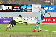 Christy Pym (1) of Exeter City makes a save with Matthew Bloomfield (10) of Wycombe Wanderers closing in during the EFL Sky Bet League 2 match between Exeter City and Wycombe Wanderers at St James' Park, Exeter, England on 10 February 2018. Picture by Graham Hunt.