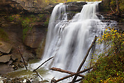 Brandywine Falls drops 65 feet (20 meters) into a lush gorge in Cuyahoga Valley National Park, Ohio. Brandywine Falls drops overs over three different types of rock: Berea sandstone at the top, Bedford shale in the middle and Cleveland shale at the bottom. The newest rock is about 320 million years old; the oldest is about 400 million. The layers were exposed and the waterfall was formed about 10,000 years ago when the last glaciers retreated from the area. The top Berea sandstone layer is the hardest and protects the softer layers below from the erosive force of the falling water.