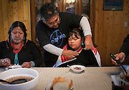 """After being up all night for Hotevilla's Basket Dance, Sarah and her granddaughter, Serena Honanie eat hominy stew for breakfast.  The Basket Dance is an annual Hopi tradition celebrating the end of harvest.  """"Corn is very important, my family belongs to the corn clan, all the way back to our grandmothers, we belong to the corn and water.  When I was growing up, I grew up to corn,"""" said Sarah Honanie."""