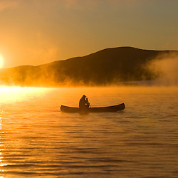 Canoeing in Lily Bay at sunrise, Moosehead Lake, Maine. (MR)