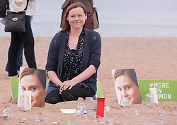 Portobello resident and former colleague of murdered MP Jo Cox, Kim Wallace, organised a tribute event on Portobello beach at which locals were invited to remember Jo and to light candles for her. Kim lighting her own candle to remember Jo.<br /> <br /> <br /> © Jon Davey/ EEm
