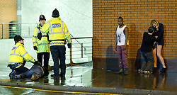 "© licensed to London News Pictures. Manchester UK. 28/11/12 Ministers are to unveil plans later for a minimum price for alcohol in England and Wales as part of a drive to tackle problem drinking. FILE PICTURED DATED: 17/12/2011. Police move a man in to recovery position and wait for an ambulance. Despite freezing temperatures, ""Mad Friday"" revellers in Manchester enjoy what is traditionally the busiest night of the year for emergency services, before Christmas. Police rush to the aid of a man who has collapsed in the street as worried friends look on. Photo credit: Joel Goodman/LNP"