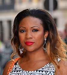 Bula Quo UK film premiere.  <br /> Mariama Goodman attend premiere of Status Quo action film featuring 12 of the rock band's classic tracks. Directed by former stunt co-ordinator Stuart St Paul, starring Jon Lovitz, Craig Fairbrass, Laura Aikman and the band members themselves. Released July 5. Odeon West End, London, United Kingdom.<br /> Monday, 1st July 2013<br /> Picture by Nils Jorgensen / i-Images