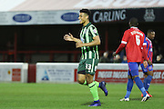 Lyle Taylor forward for AFC Wimbledon (33) celebrates after putting AFC  Wimbledon up 0-1 during the Sky Bet League 2 match between Dagenham and Redbridge and AFC Wimbledon at the London Borough of Barking and Dagenham Stadium, London, England on 19 April 2016. Photo by Stuart Butcher.