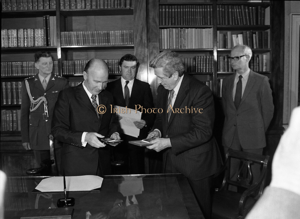 New Government Receive Seals Of Office.   (N84)..1981..30.06.1981..06.30.1981..30th June 1981..The newly elected Fine Gael /Labour coalition government under Dr Garret Fitzgerald received their seals of office from President Hillery at Áras an Uachtaráin today...President Hillery is pictured presenting Dr Garret Fitzgerald with his seal of office as Taoiseach of the newly elected government.