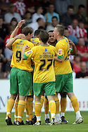 London - Saturday August 15th, 2009: Jens Berthel Askou (hidden) of Norwich City celebrates his side's first goal with his team mates during the Coca Cola League One match at St James Park, Exeter. (Pic by Mark Chapman/Focus Images)