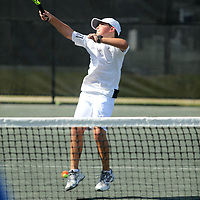 Jax Coker hits the ball back to his Coach, Omar Alcaino, Tupelo Junior Tennis Team Coach, during hitting practice Thursday afternoon at the Tupelo Country Club. The team has advanced to the USTA Southern Sectionals.
